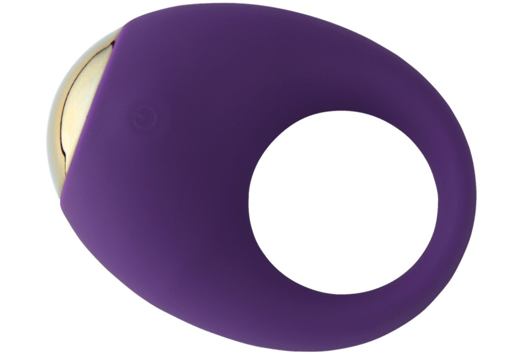 The ring, which has a hole in the center, a vibrator on one side, and is made of stretchy silicone