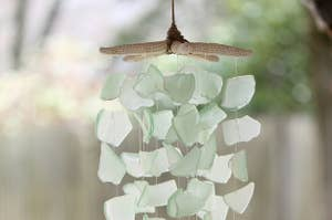 Soft green sea glass shards hung from a starfish into a chime