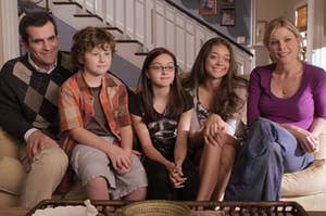 """The Dunphys sit on their couch during an episode of """"Modern Family."""""""