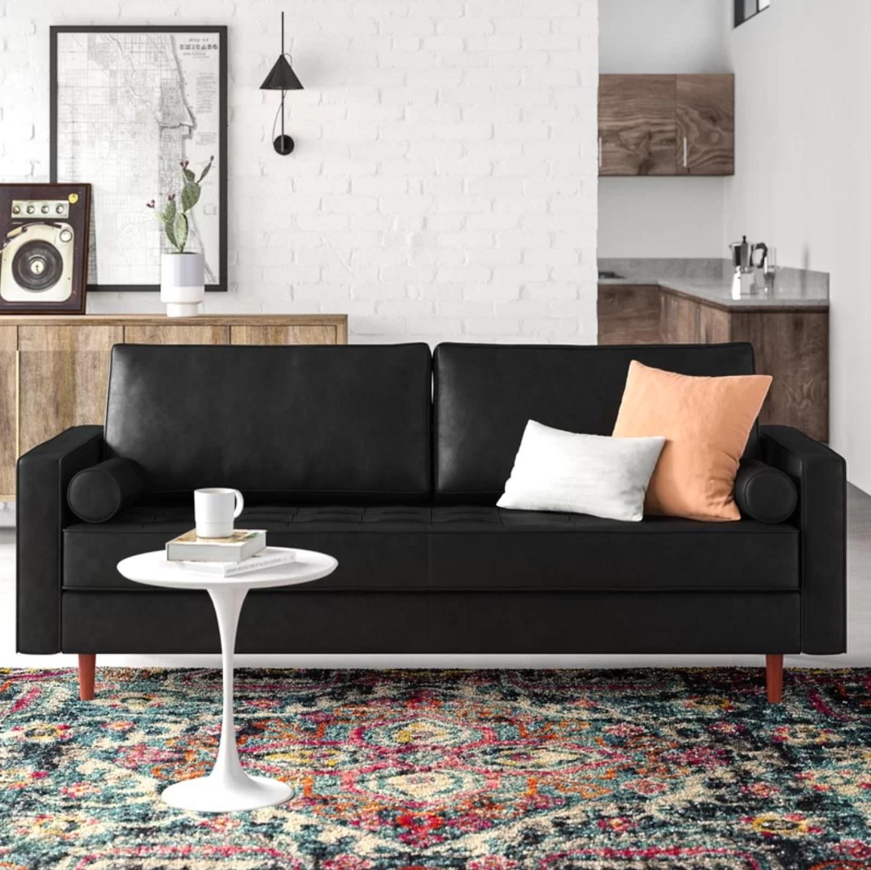 A genuine leather sofa in vintage black