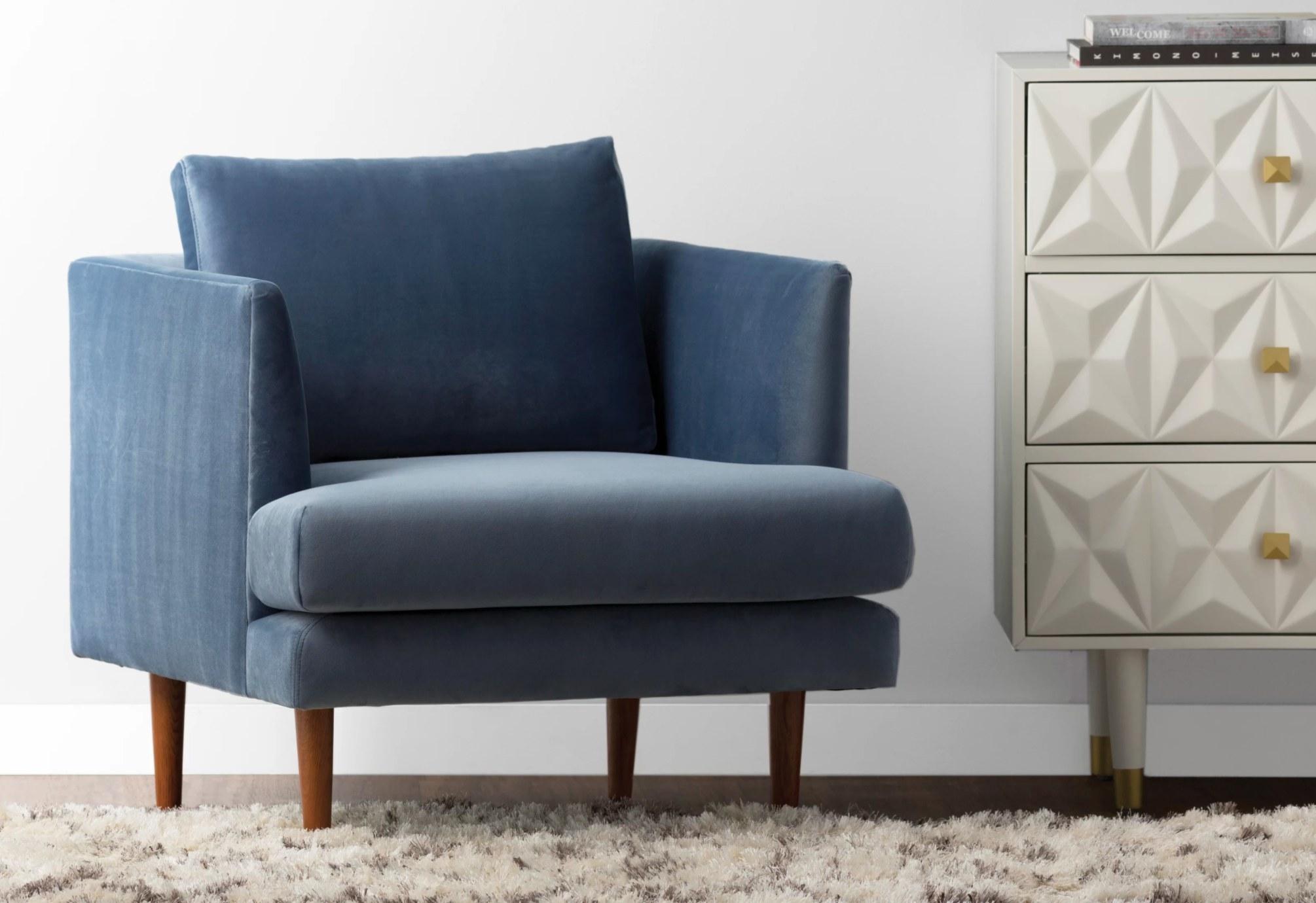 The deep velvet armchair in blue