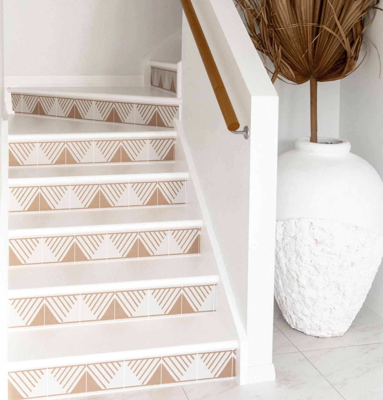 tan triangle with lines stickers on the vertical part of a set of stairs