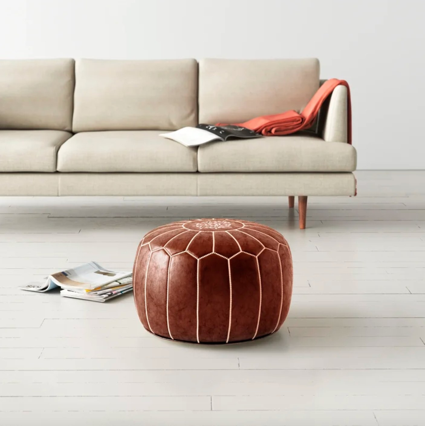 The leather pouf in brown