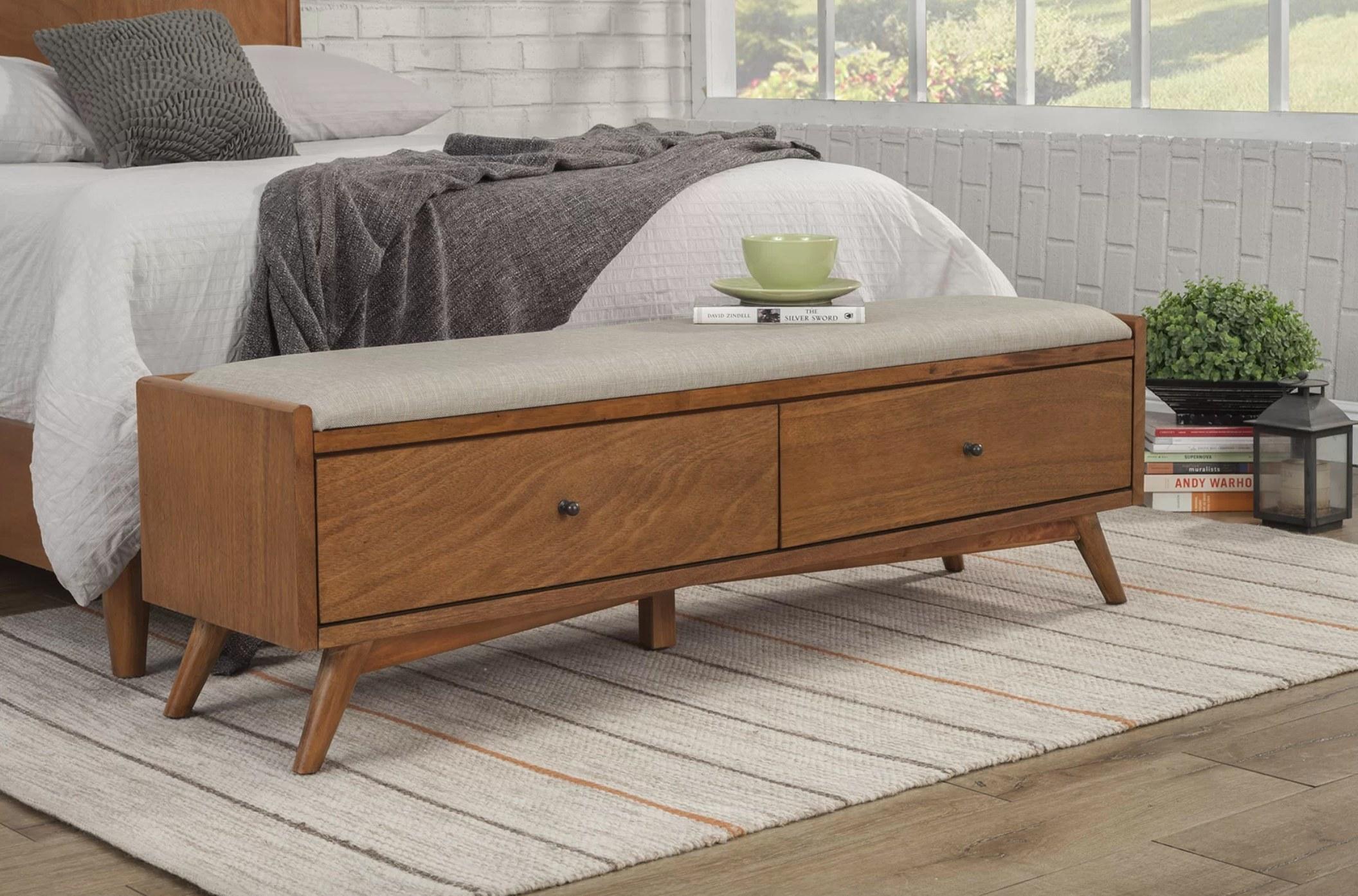The brown wood drawer storage bench