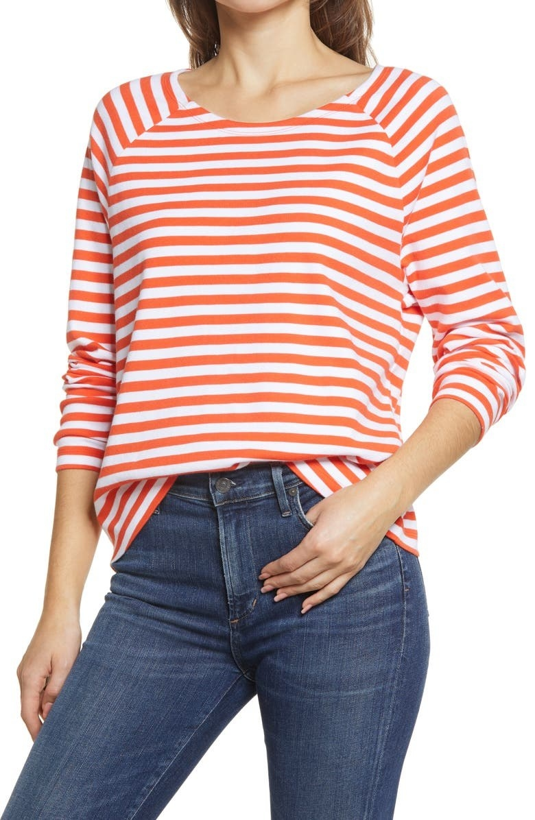 model wearing an orange and white striped long sleeve t shirt