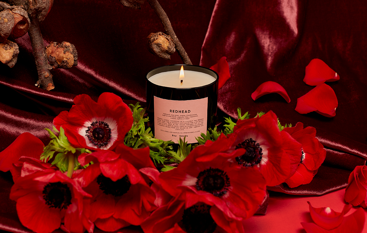 The Redhead candle surrounded by poppies