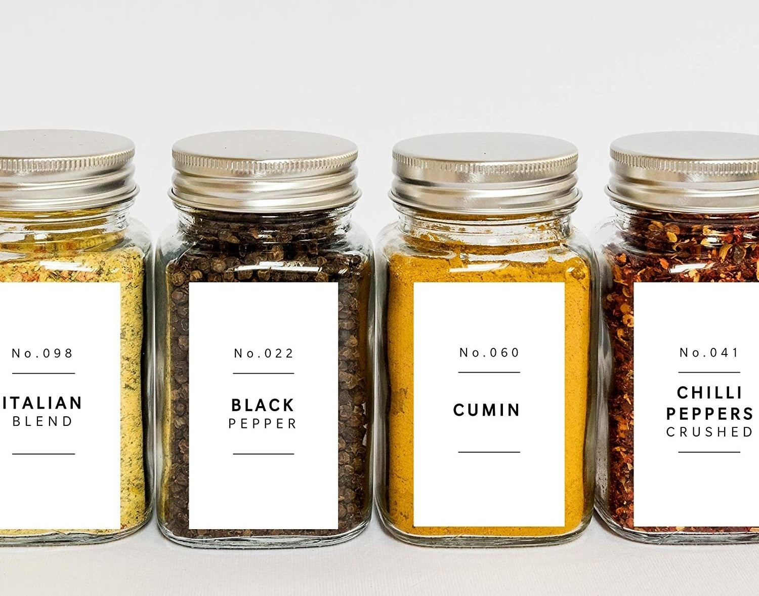 A set of spice jars with neat minimalist labels on the front