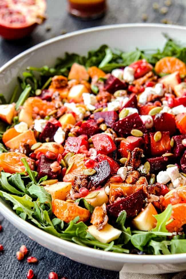 A beet and apple salad with goat cheese and greens.