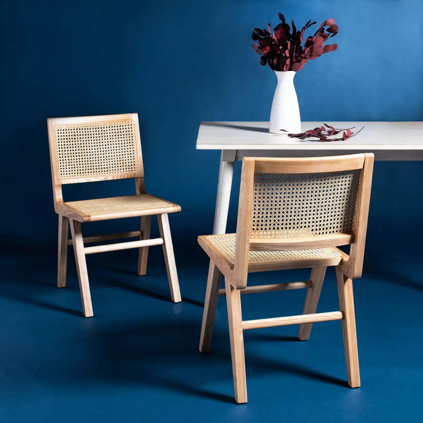 The dining chairs in natural
