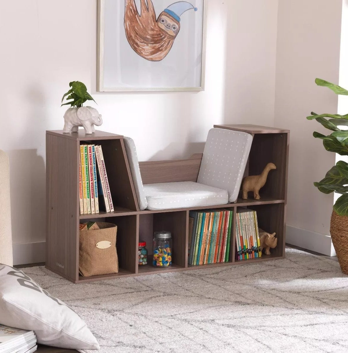 The wooden shelving unit with cushions