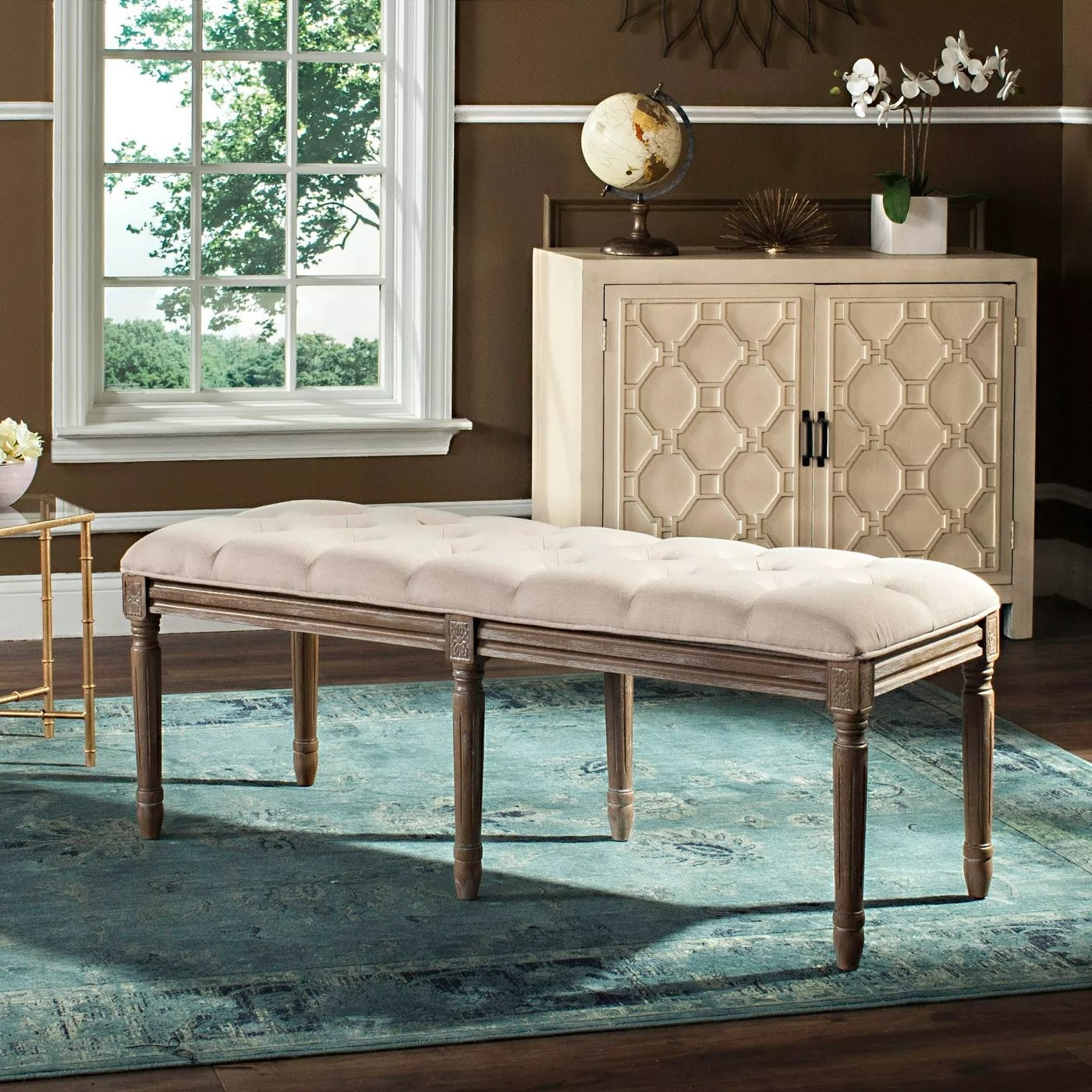 The wood bench with a beige cushion