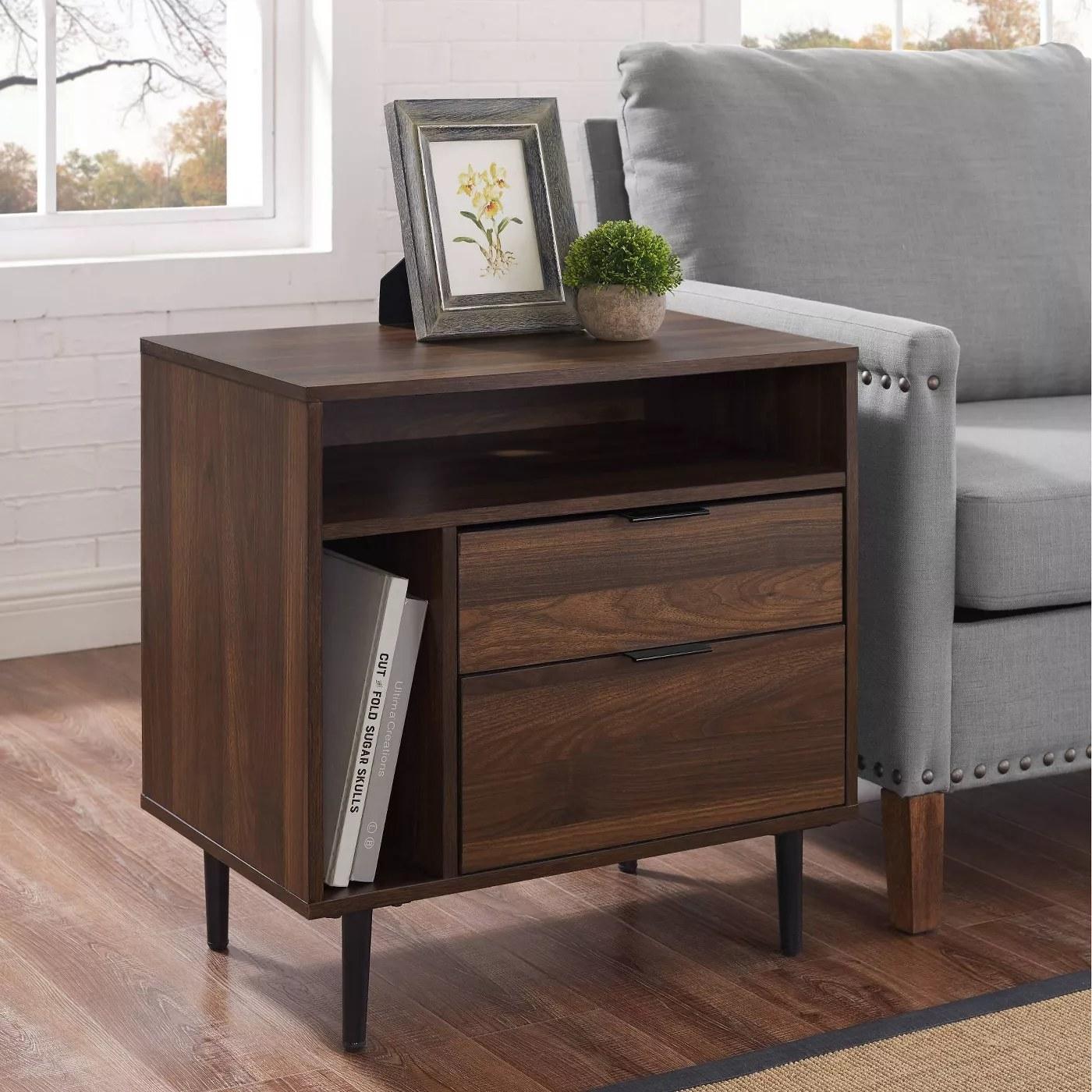 The nightstand in dark walnut