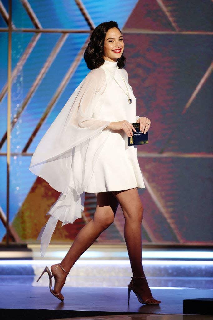 Gal wearing a flow-y short dress and heels