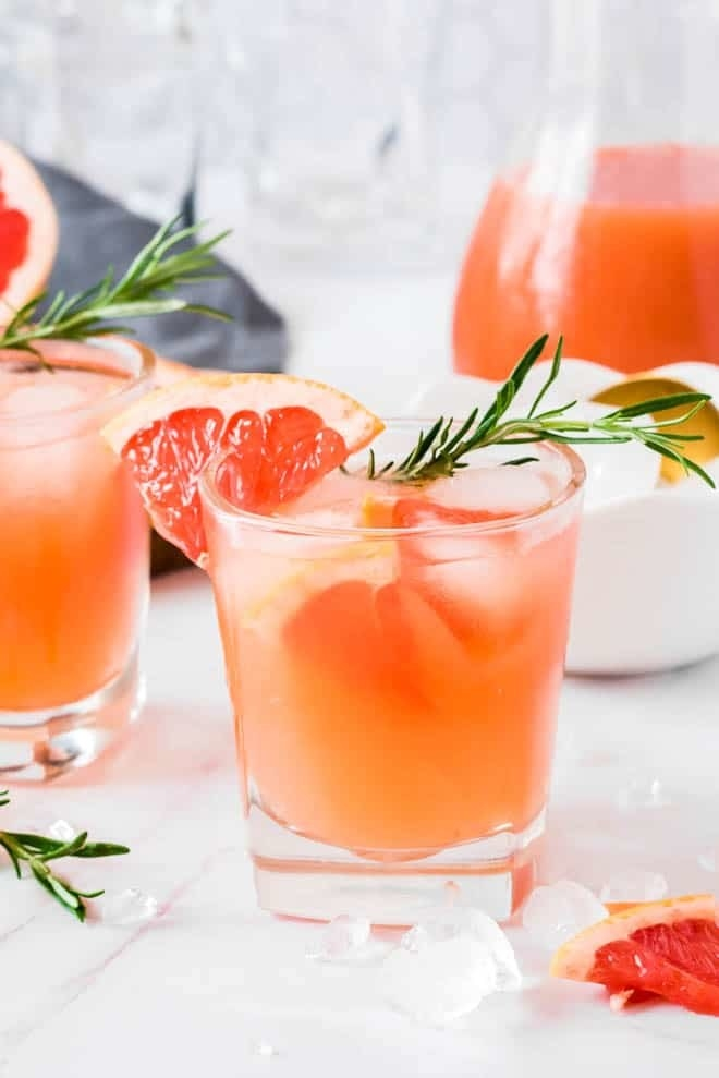 Grapefruit gin fizz cocktails with rosemary.