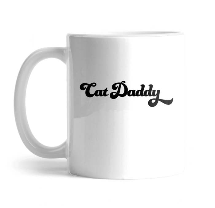 "The mug that says ""cat daddy"""
