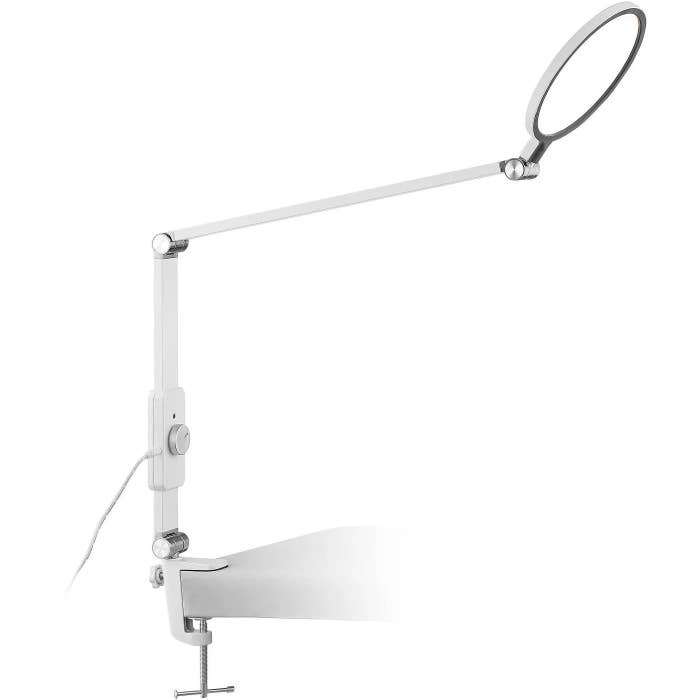 The white lamp with a dimmer switch and two rotating hinges