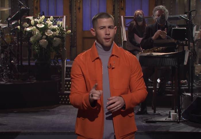 Nick Jonas speaking during the opening to SNL