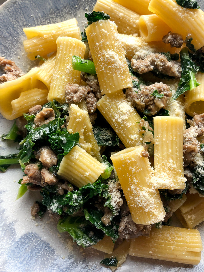 Rigatoni with sausage and kale and Parmesan cheese.