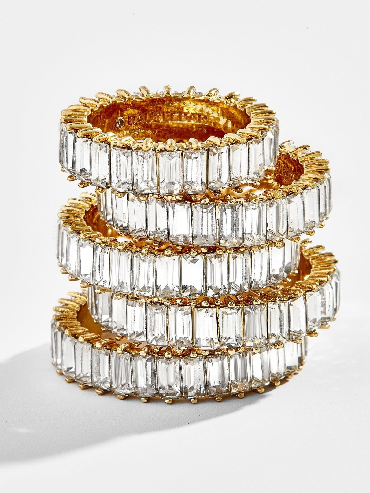 A stack of baguette clear rhinestone rings