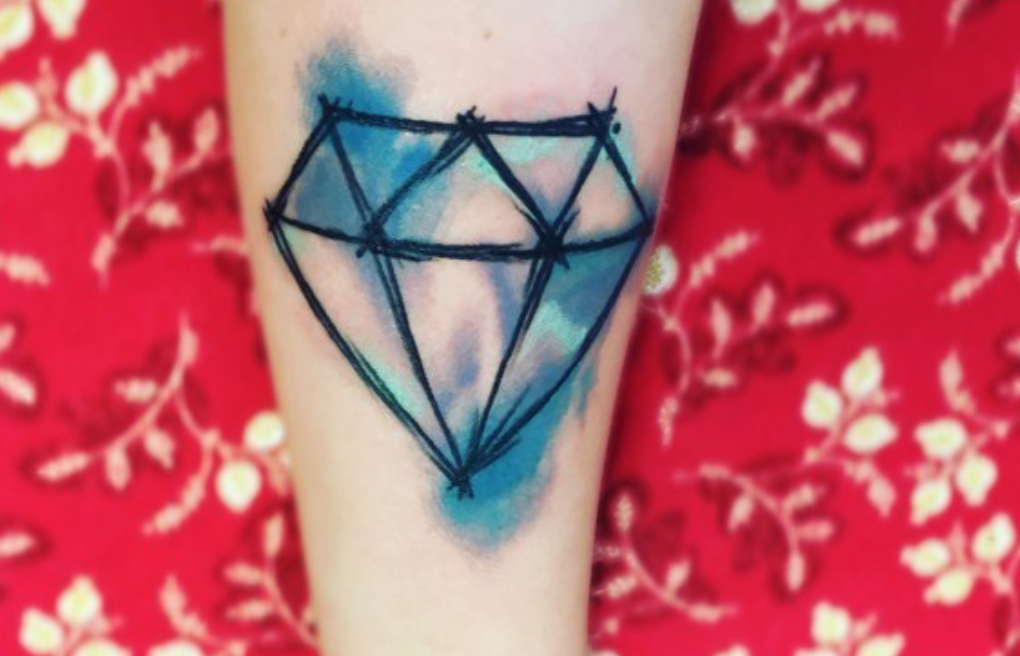 Blue watercolor tattoo in the shape of a diamond