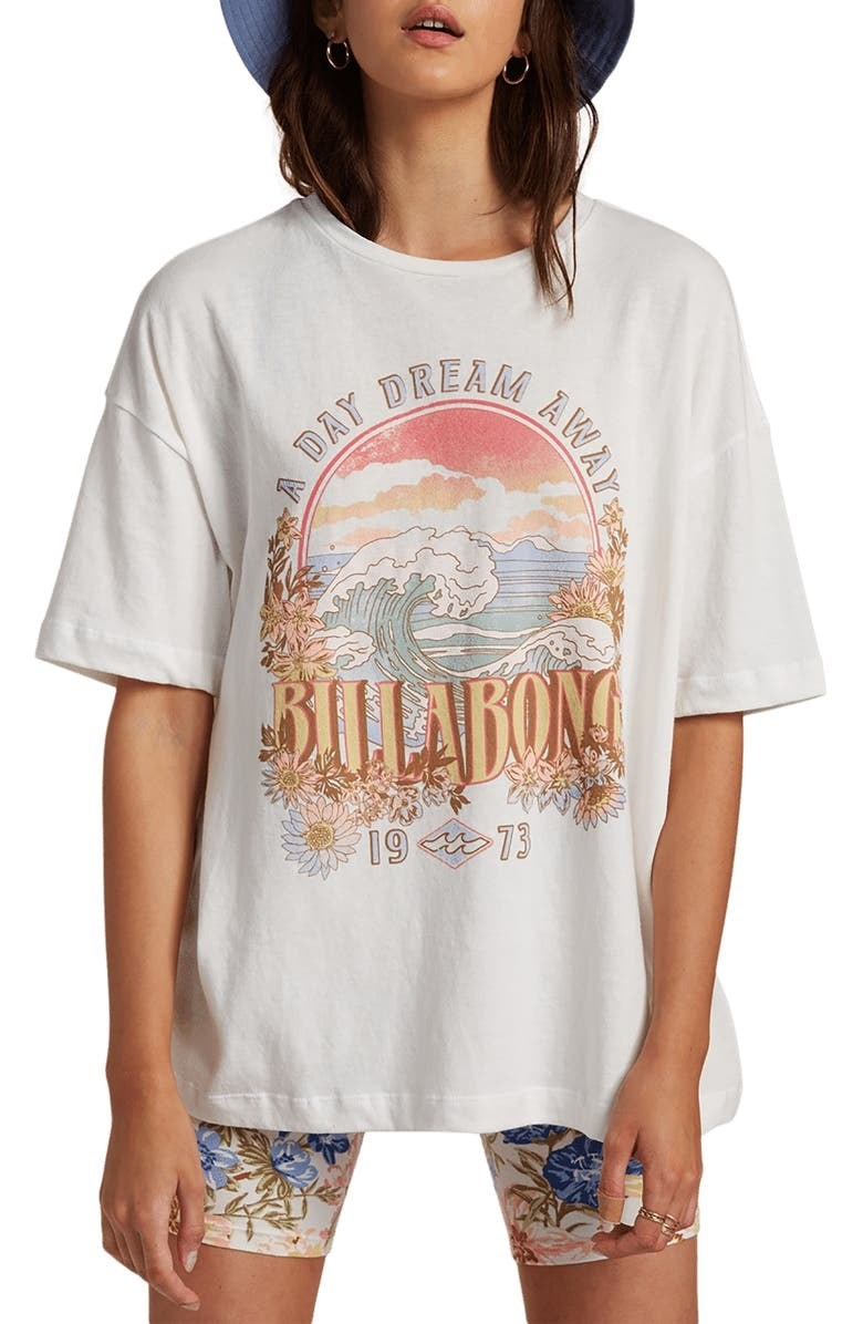 person wearing a white billabong graphic t shirt with bike shorts