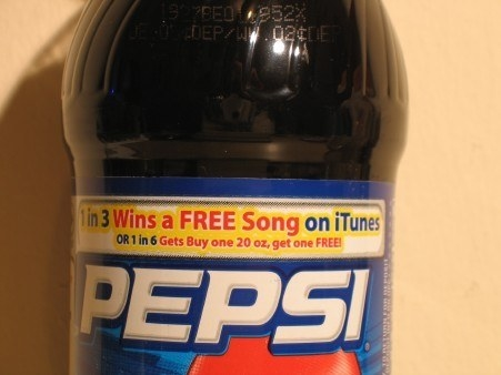 A Pepsi bottle with the iTunes contest on the label