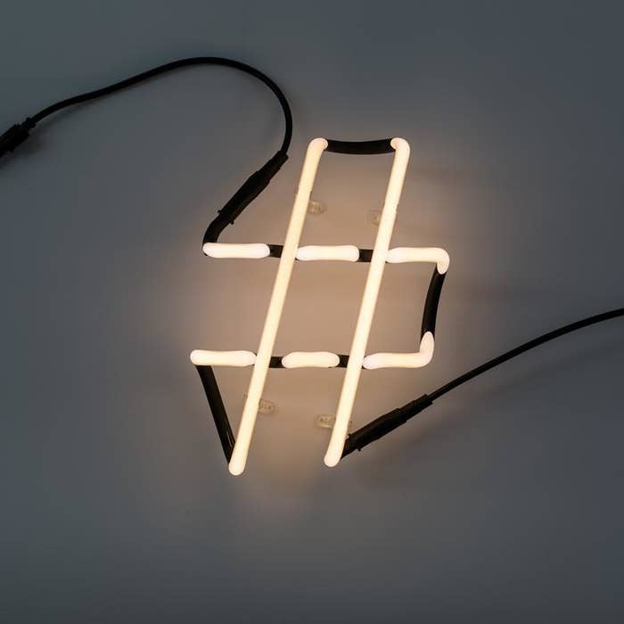 the seletti number sign neon lamp on a wall