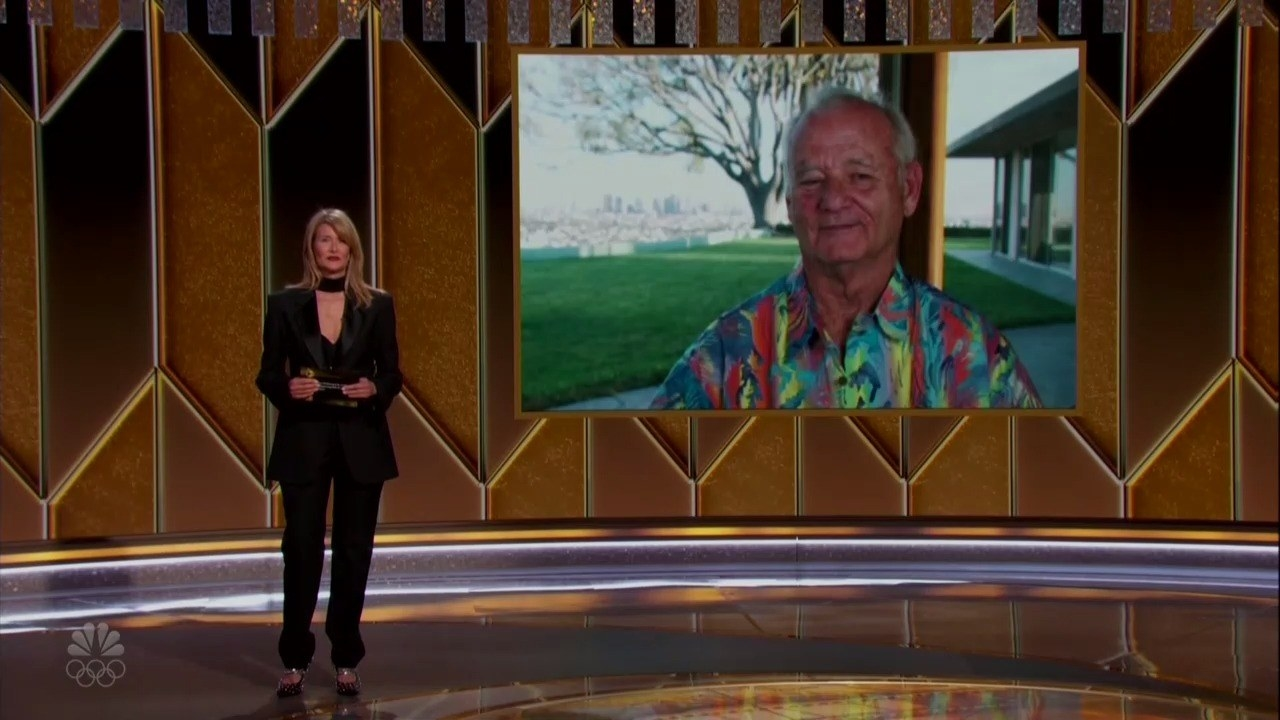 Laura Dern presents an award while Bill Murray sits at home in a Hawaiian shirt