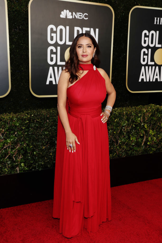 Salma poses in her one-shoulder Grecian-style gown decorated with a brooch at her neck