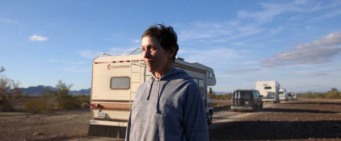 Frances McDormand as Fern in Nomadland, watching RV drive by