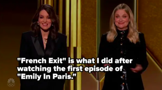 """Tina and Amy on stage with the caption: """"French Exit is what I did after watching the first episode of Emily in Paris"""""""