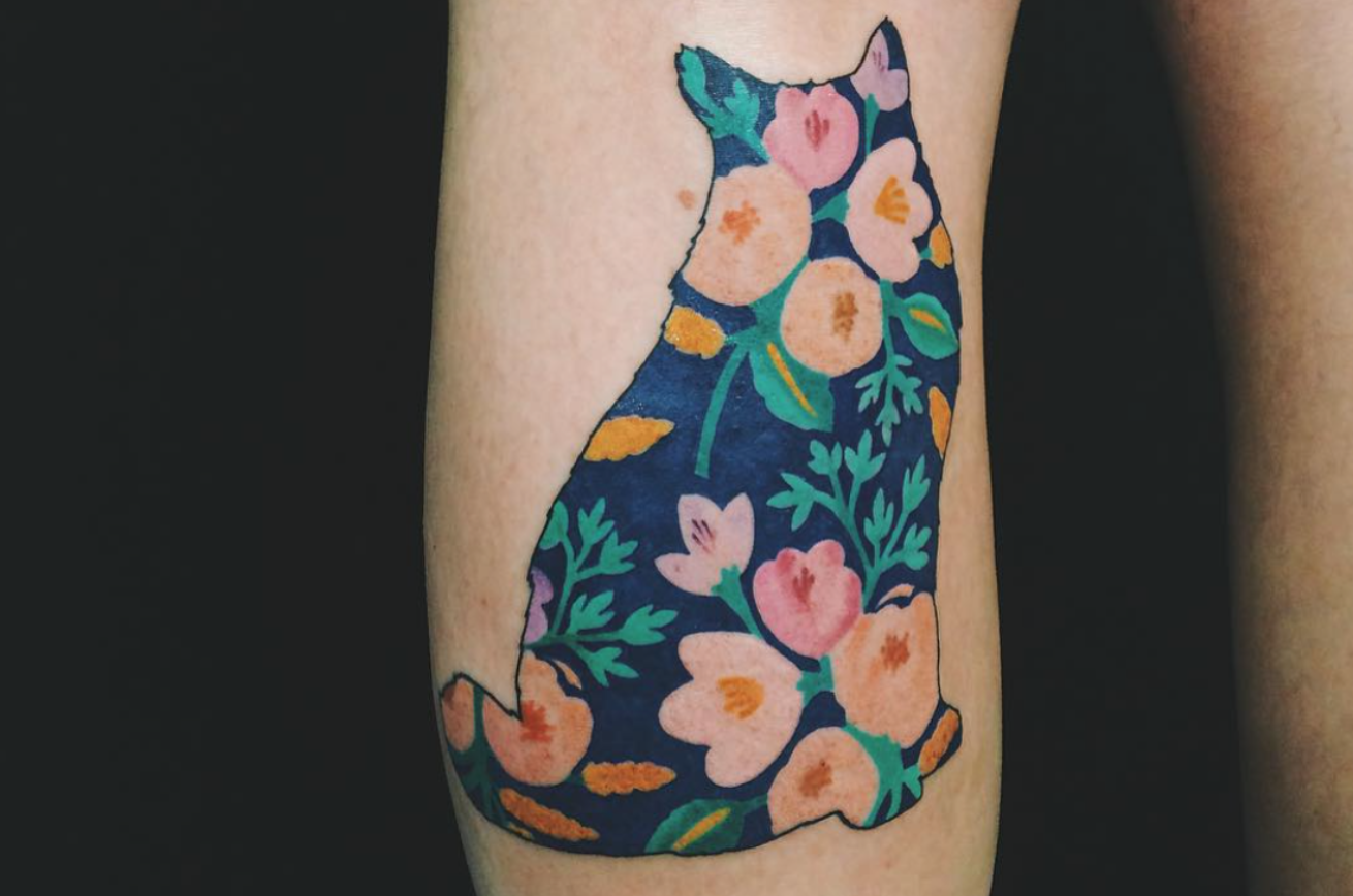 Cat shape with flowers and leaves tattoo