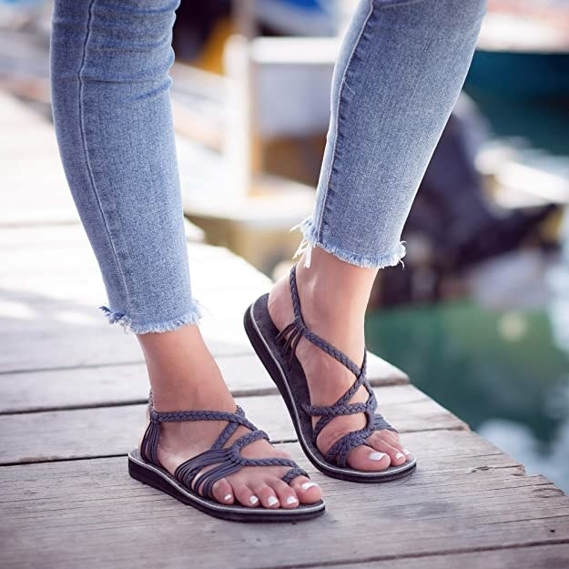 model wearing sandals with jeans