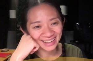 Chloé Zhao smiling over Zoom while winning her Golden Globe award