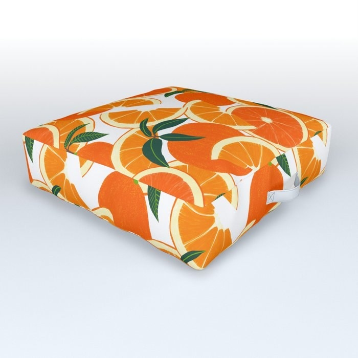 the bright, juicy, fruity floor cushion decorated with oranges