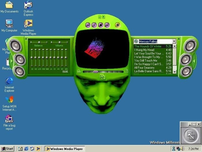 A windows media player on a desktop screen that looks like a green human head