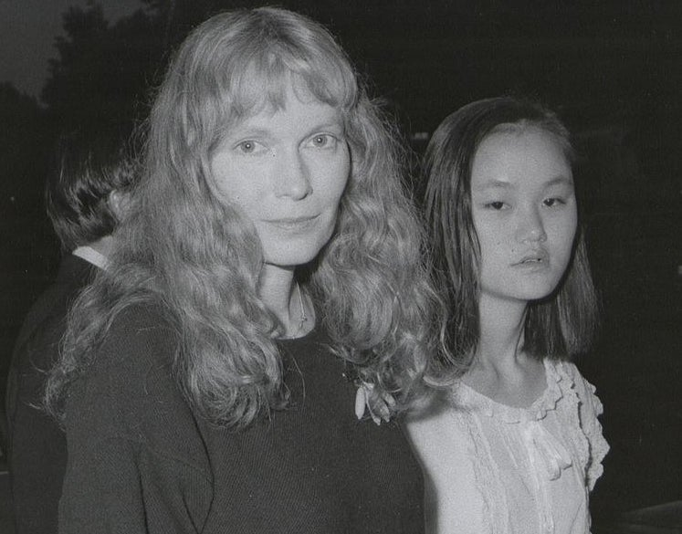 Archived photo of Mia Farrow and a Soon-Yi attending an event