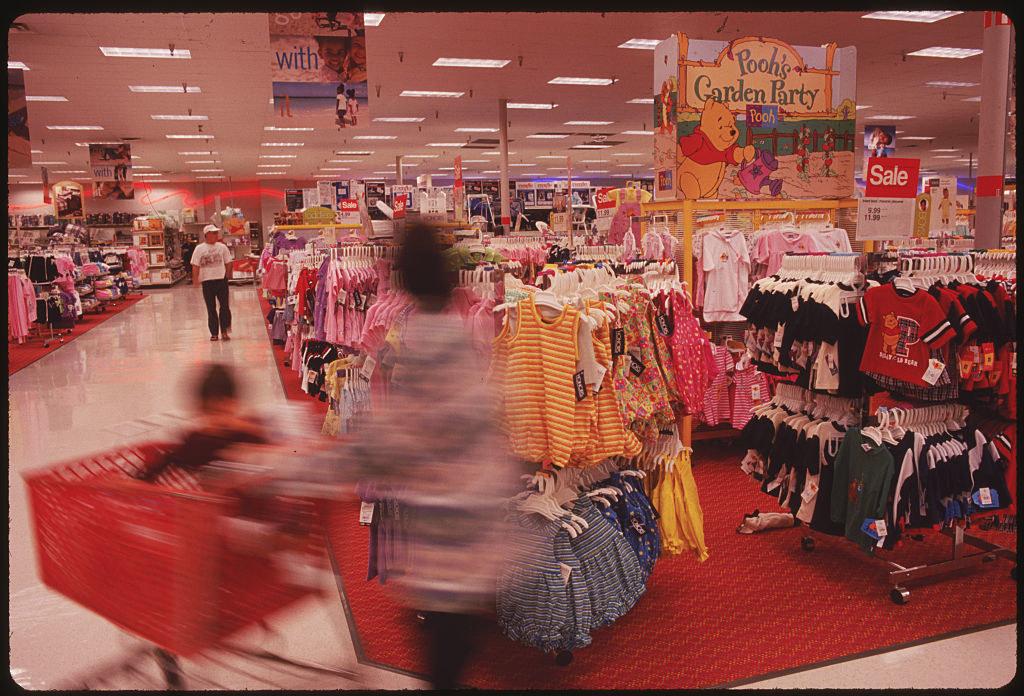 A shopper walking past a kids section