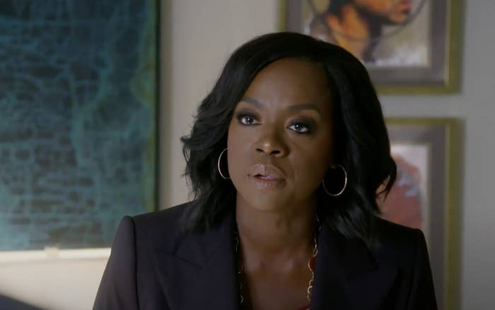 Annalise wearing a blazer and hoops