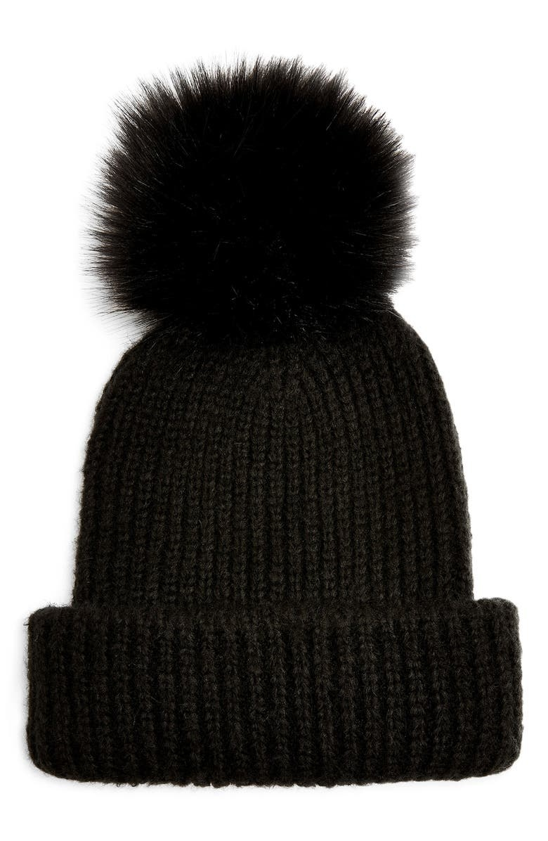 black knit beanie with a pom on the top