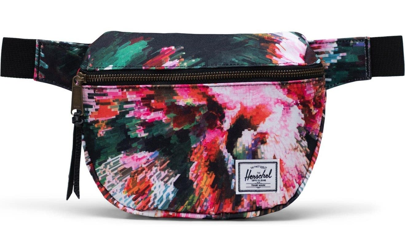 colorful, abstract belt bag with the herschel logo on it