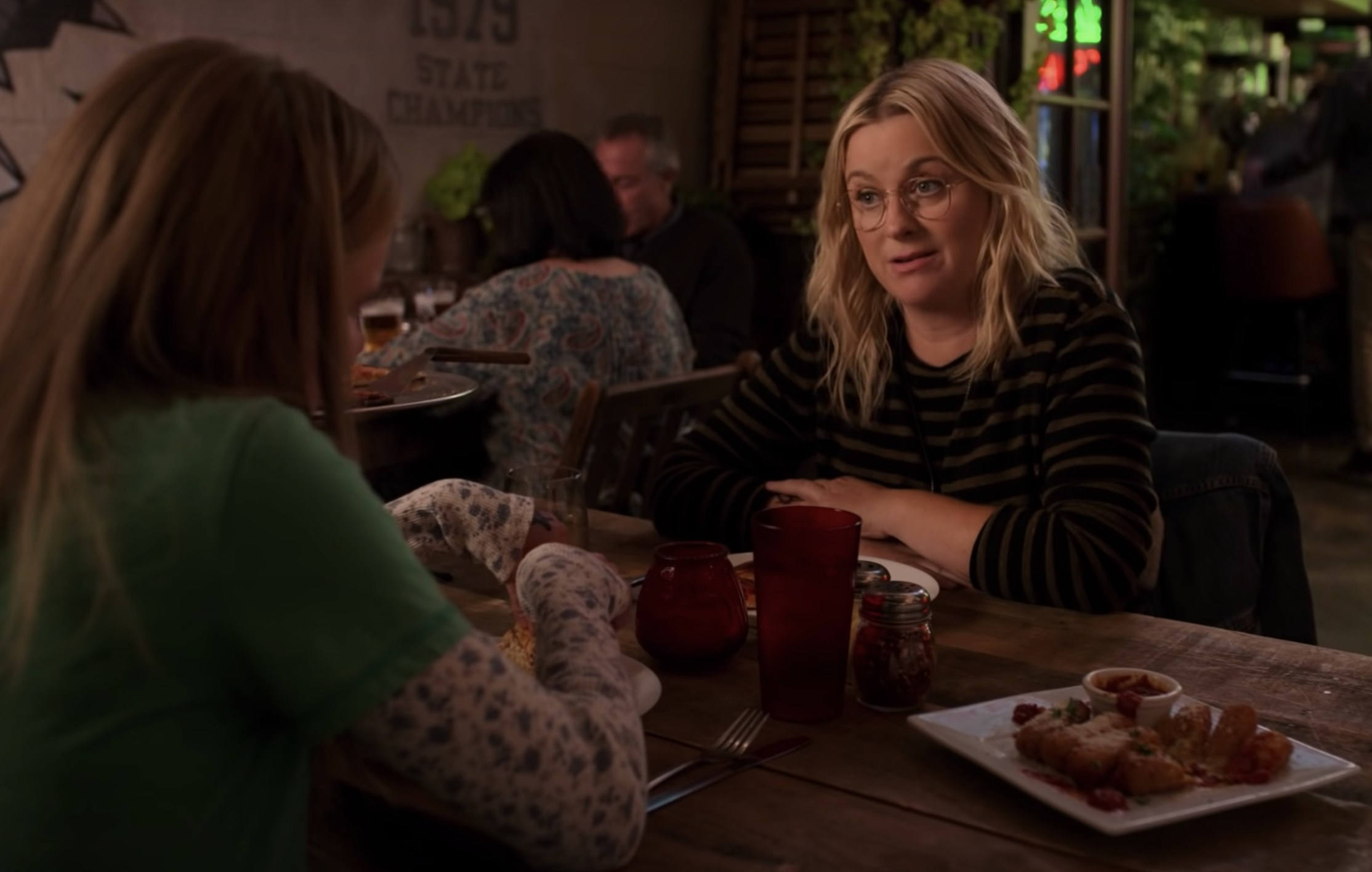 Amy sits across from her daughter in a screenshot from Moxie