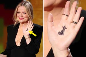 Amy Poehler with hand drawn hearts on her hand