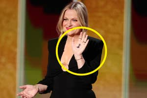 Amy shows off the drawing on her hand during the Golden Globes