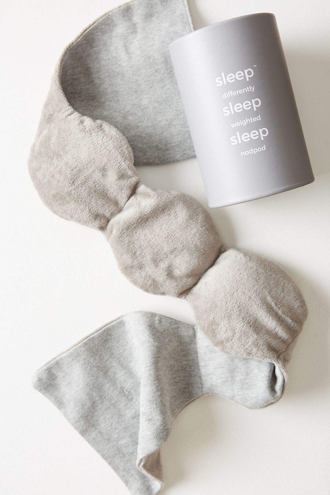 The grey fleecey nodpod eye mask with no strap
