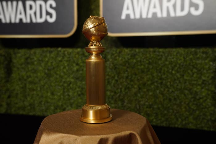 A Golden Globes award on top of a table