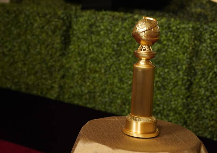 A Golden Globes trophy atop a table