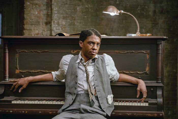 """Chadwick sitting and leaning against a piano in """"Ma Rainey's Black Bottom"""""""