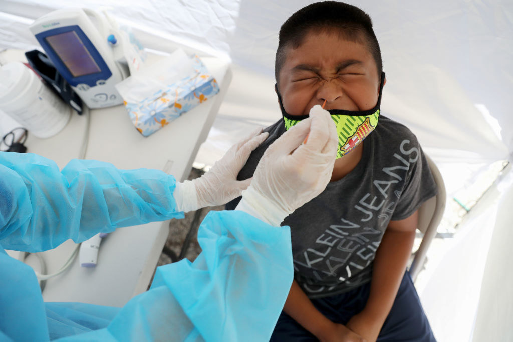 Young boy getting tested for coronavirus