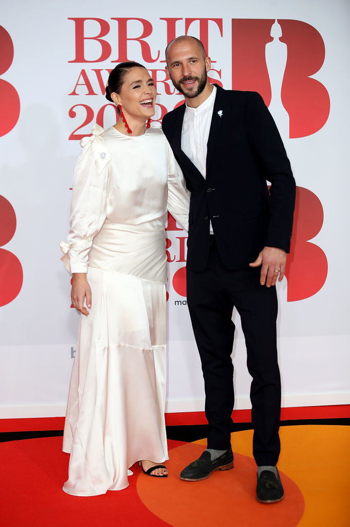 Jessie Ware (L) and Sam Burrows attend The BRIT Awards 2018 held at The O2 Arena on February 21, 2018 in London, England